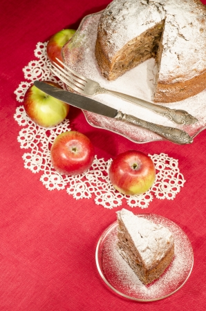 rum cake: Applesauce raisin rum cake for christmas table, blurred background Table decorated with lacy napkin. From series of Merry Christmas