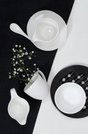 White porcelain on black and white linen tablecloths. White porcelain on black and white linen tablecloths. Abstract still life. From series Playing with Color photo