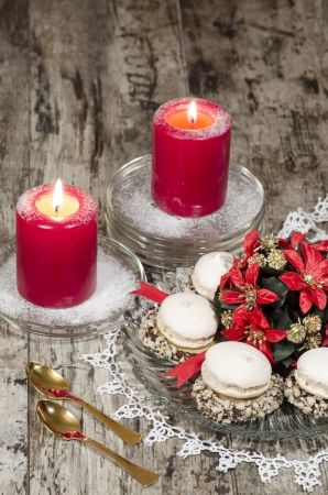 Christmas decoration with candles, cookies and ribbons, blurred background.  From series Christmas and New Year photo