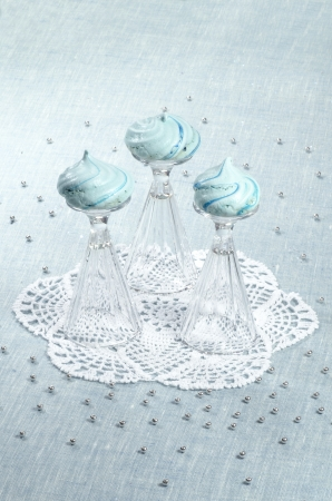 Three homemade meringue shaped domes on crystal wine-glasses From series Christmas and New Year photo