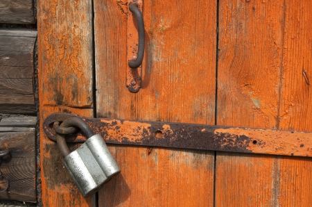 Old wooden door with padlock,  fragment. From series backgrounds and textures photo