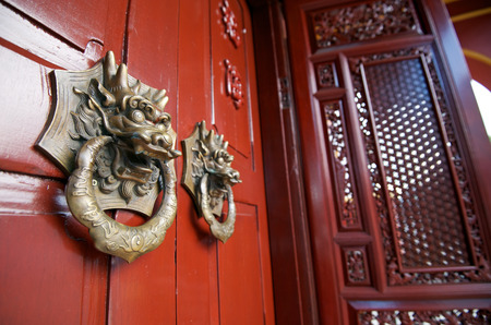 chinese traditional house: traditional door knocker at the chinese house