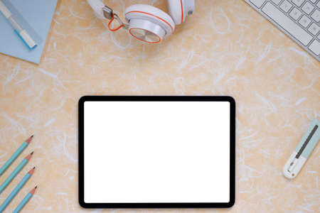 Creative flat lay of workspace desk, office stationery, keyboard, headphones and lifestyle objects on orange background with copy space Stok Fotoğraf