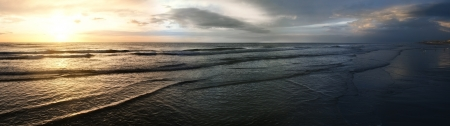 panorama of a dramatic sunset at the atlantic after a storm