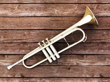 Trumpet on wood background - 3D render photo
