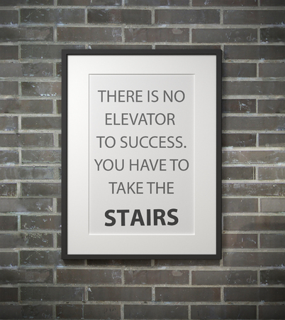 encouragements: Inspirational quote on picture frame over a dirty brick wall. THERE IS NO ELEVATOR TO SUCCESS. YOU HAVE TO TAKE THE STAIRS.