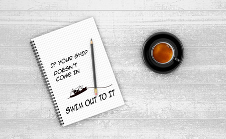 come in: Inspirational quote on notepad. IF YOUR SHIP DOESNT COME IN SWIM OUT TO IT. Stock Photo