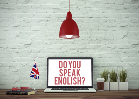 english dictionary: Do You Speak English? Laptop on Wooden Desk With English Dictionary and United Kingdom Flag. Stock Photo