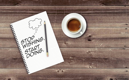 wishing: Inspirational quote on notepad. STOP WISHING. START DOING