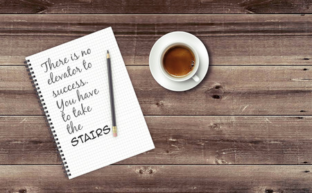 happiness or success: Inspirational quote on notepad. THERE IS NO ELEVATOR TO SUCCESS. YOU HAVE TO TAKE THE STAIRS.