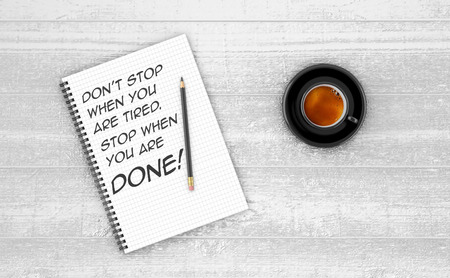 happiness or success: Inspirational quote on notepad. DONT STOP WHEN YOU ARE TIRED. STOP WHEN YOU ARE DONE! Stock Photo