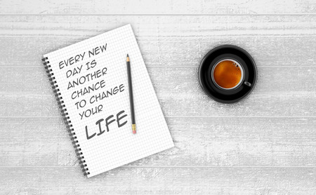 new day: Inspirational quote on notepad. EVERY NEW  DAY IS  ANOTHER  CHANCE  TO CHANGE  YOUR LIFE.