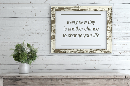 Inspirational quote on picture frame. Every new day is another chance to change your life. Stock Photo