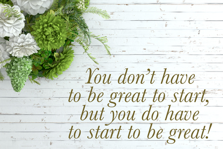 but: Inspirational quote on wooden table. You don�t have to be great to start, but you do have to start to be great.