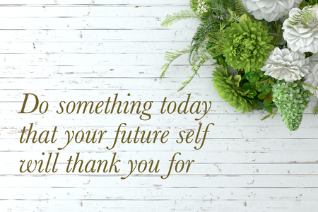Inspirational quote on wooden table. Do something today that your future self will thank you for.