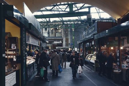London,Uk - April 15, 2016: Visitors and shoppers in the covered section of Borough Market in London, England.