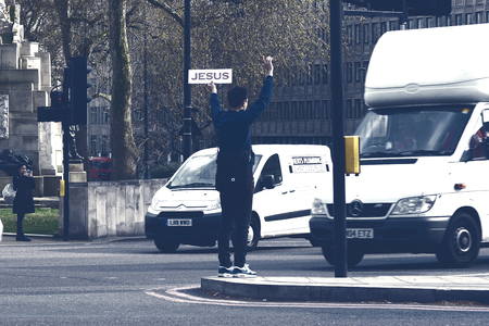 godly: London,Uk - April 15, 2016: Man in the street holding a sign and preaching about Jesusin London, England.