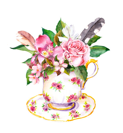 teaparty: Vintage tea cup with pink flowers and feathers in boho chic style. Ditsy feminine watercolor for teaparty or teatime Stock Photo
