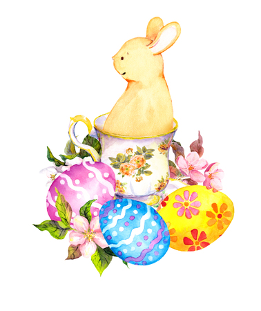 teaparty: Cute easter bunny in tea cup, with colored eggs, flowers. Watercolor Stock Photo