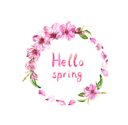 Flowering cherry tree, apple blossom, spring petals of pink flowers. Floral wreath, note Hello spring . Watercolor round border