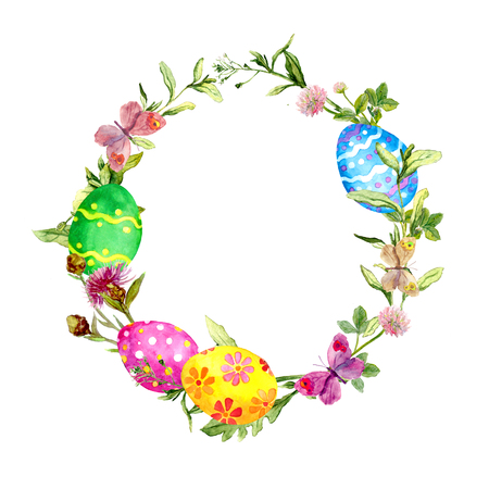 Easter wreath with easter eggs in grass, flowers. Circle border. Watercolor