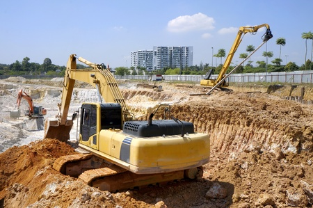 Heavy excavator loader at soil moving works in construction site Stock Photo - 13177160
