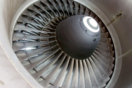 Closeup of aircraft jet engine at the hangar  photo