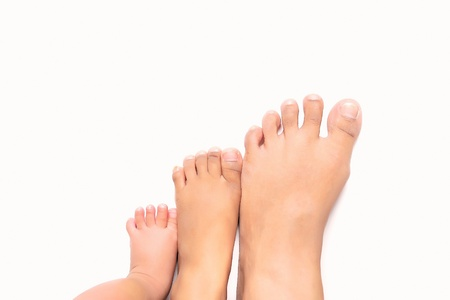Steps to success - multi size foot from infant, young children and adult Stock Photo - 13208454
