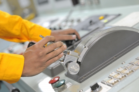 job engine: Shipping officer controlling shipping vessel at engine room