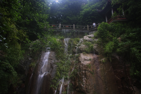 Mogan Falls, located in Deqing County, Zhejiang Moganshan Scenic Area.   Reklamní fotografie