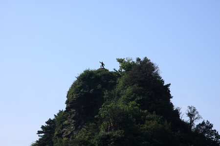 poems: Taoist Temple - Wudang Mountain in Shiyan City, Hubei Province territory, a man on the mountain. Stock Photo