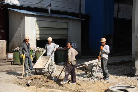 crossings: workers at Sister divisions port crossings with Myanmar town Editorial