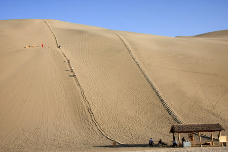 "crescent lake: Mingsha, located in the southern suburbs of Dunhuang City, Gansu Province, due to the sand moving sound derived from the name of Dunhuang ""Eight."" Crescent Lake, surrounded by Mingsha, because the water resembles a crescent named. Stock Photo"