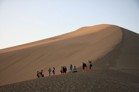"""crescent lake: Mingsha, located in the southern suburbs of Dunhuang City, Gansu Province, due to the sand moving sound derived from the name of Dunhuang """"Eight."""" Crescent Lake, surrounded by Mingsha, because the water resembles a crescent named. Editorial"""