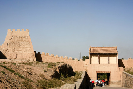 "jiayuguan: Jiayuguan in Jiayuguan City, Gansu Province, the western end of the Ming Great Wall is the first re-pass, but also the ancient ""Silk Road"" traffic fortress. Ming Dynasty Great Wall is the western end of the starting point, along the Great Wall b Stock Photo"