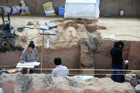 huang: Terracotta Warriors pit located in this Lintong, Shaanxi Province, is one of the greatest discoveries and Horses of Qin Shi Huang Mausoleum Pictured staff in cleaning up the scene. Editorial
