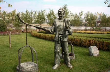 waterwheel: Statue of a man selling chinese food, Waterwheel Park Lanzhou