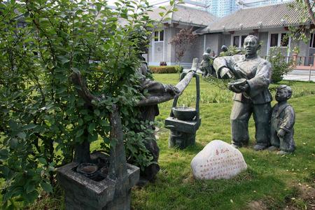 waterwheel: Statue of a man selling traditional drink, Waterwheel Park Lanzhou