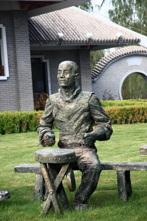 scrapers: Statue of a man playing instrument, Waterwheel Park Lanzhou
