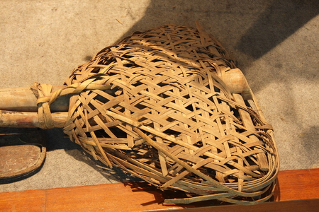 sludge: Mud sieve-like utensil used to clean up the river sludge inside. Collection in Huzhou, Zhejiang Museum. Editorial