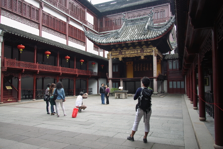 visitors area: Shanghai Temple tourist area is important Taoist temples in Shanghai, visitors take photo at garden.