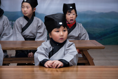 scriptures: children dressed in Chinese clothes.