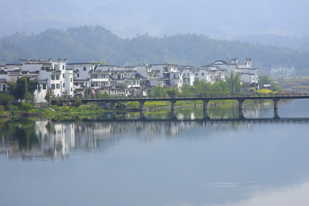 hometown: Great hometown - Riverside is located in the scenic Wuyuan, Jiangxi Province, the famous attractions that Xiao Jiangzong Riverside shrine temple, brick, wood carving, stone carving realistic shape, full of elegant architectural elegance.  Pictured Bay Stock Photo