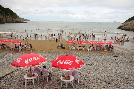 ao: Large sand beach Ao Wenzhou City, Zhejiang Province, the whole beach shaped like a crescent, flat open, pleasant scenery. Editorial