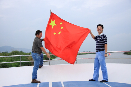 five pointed: Yuhuan County of Zhejiang Province held the flag of tourists. Editorial