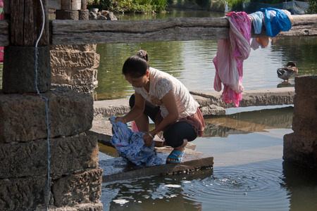 """public welfare: Pavilion is the most unique laundry cis most gentle charity building. Cis men go abroad to Southeast Asia Myanmar traditional """"walk barbarian side"""", year after year, day after day, they miss home, miss their loved ones, for the women of the fami Editorial"""