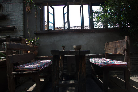 certain: Bar, decorative materials in the bar with a certain ethnic characteristics owner purchases come from the southwest border of Yunnan minority people in the demolition of houses.