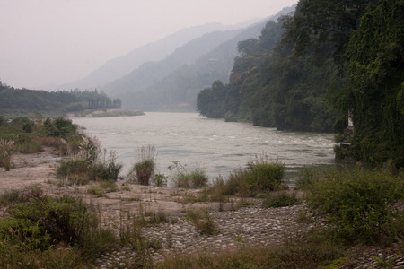embody: Bottle is in dujiangyan one of the world cultural heritage. More than 2000 years has played a role of flood control and irrigation characterized by a diversion dam the Grand water project embody the ancient Chinese Han people are hardworking brave wisdom  Stock Photo
