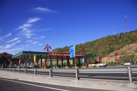 toll: Paying toll near Jing Shan mountain Editorial