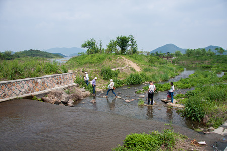 stepping stone: Crossing the river on the stepping stone